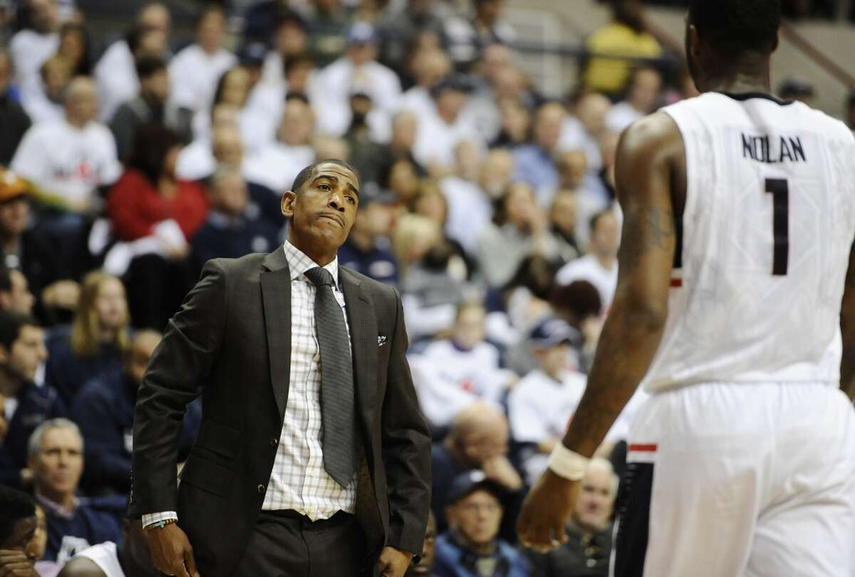Connecticut head coach Kevin Ollie, left, reacts toward Connecticut?'s Phillip Nolan, right, during the first half of an NCAA college basketball game, Sunday, Nov. 30, 2014, in Storrs, Conn. (AP Photo/Jessica Hill)