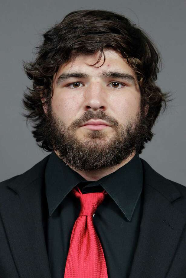 FILE - In this file image taken on Wednesday, Sept. 11, 2013, and provided by Ohio State University, college football player Kosta Karageorge poses for a photo in Columbus, Ohio. Police tell media outlets Sunday, Nov. 30, 2014, they believe a body found near the campus was that of 22-year-old Karageorge. (AP Photo/Ohio State University, Jay LaPrete, File) ORG XMIT: NY152 Photo: Jay  LaPrete / Ohio State University