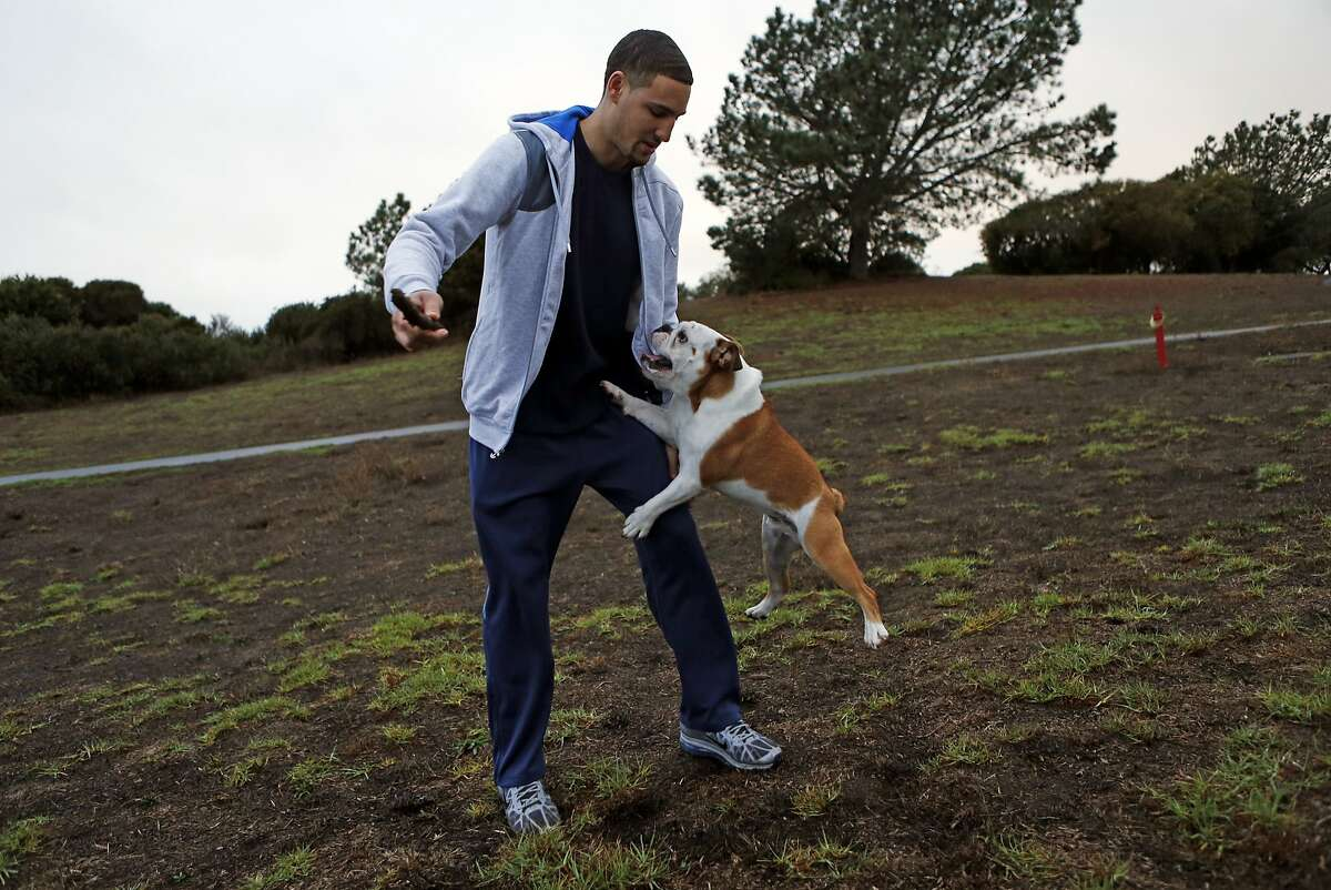 Golden State Warriors' Klay Thompson plays with his dog, Rocco, at Cesar Chavez Park in Berkeley.