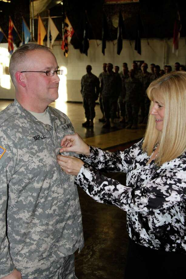New York Army National Guard Cindy Yaple pins a single brigadier general star on her husband, Gary S. Yaple during a promotion ceremony at the New York Army National Guard Headquarters in Troy.