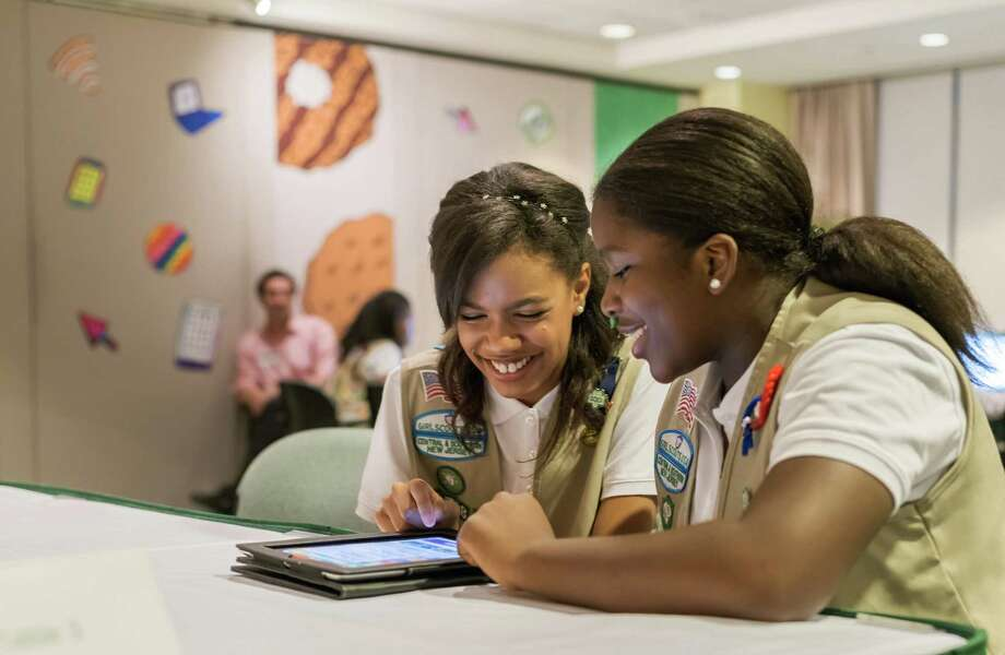 In this undated photo released by Girl Scouts of the USAGirl Scouts,  Bria and Shirell practice selling cookies on one of two new digital platforms. It's the first time Girls Scouts of the USA has allowed sale of cookies using a mobile app and personalized websites. The Digital Cookie program is intended to enhance, not replace, traditional use of paper spreadsheets. Photo: Girl Scouts Of The USA, AP / Girl Scouts of the USA