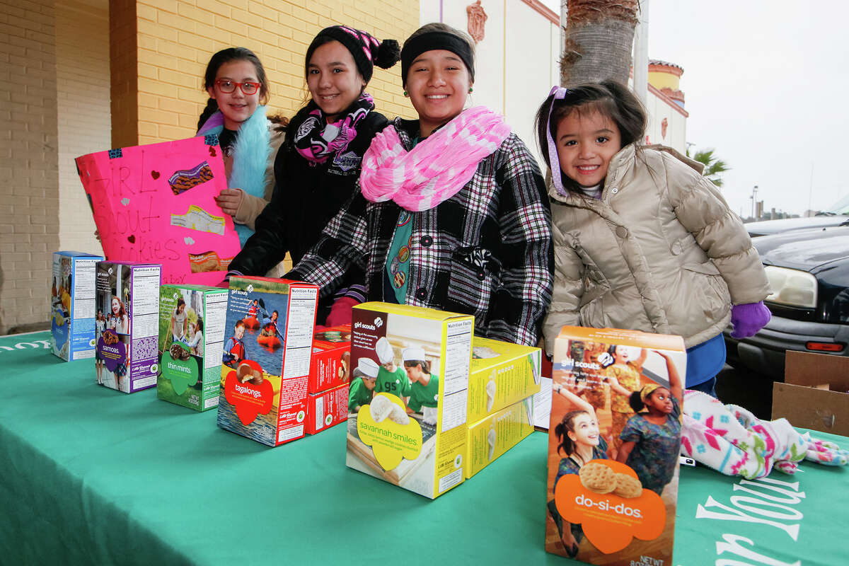 Nadia Gonzales (from left), 11, katie Schilling, 12, Anyssa Gutierrez, 11, and Melanie Limon, 5, with Girl Scout Troop 250 from St. John Bosco, braved near freezing temperatures to sell cookies in front of the H-E-B at 721 Castroville Road on Friday, Feb. 7, 2014. Photo by Marvin Pfeiffer / EN Communities