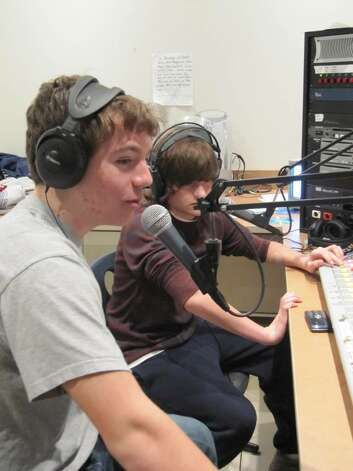 Staples High School freshmen Alex Zuckerman and Greg Shikowitz, both musicians, host a music show for Wrecker Radio. Photo: Kirk Lang / Westport News
