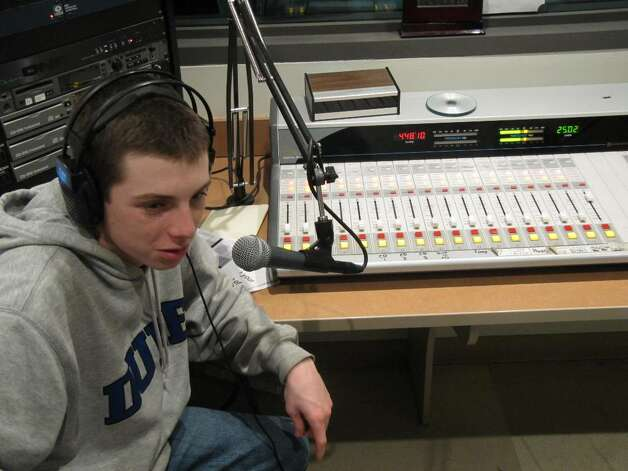 "Staples High School junior Eric Gallanty discusses sports on his Wrecker Radio show, ""Two Guys and a Gal."" Photo: Kirk Lang / Westport News"
