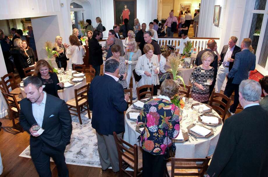 The Stamford Museum and Nature Center in Stamford, Conn., celebrated its first Farm to Table Supper on Saturday, Sept. 20, 2014, with seasonal foods paired with exquisite wines featuring Chef Brian Lewis. The event helped to support the museum's programs and services. Guests gather here at the Bendel Mansion Museum Galleries before setting down to dinner. Photo: Contributed Photo / Stamford Advocate Contributed photo
