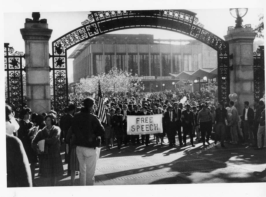 Mario Savio and other student protestors march through Sather Gate on the UC Berkeley campus, heading for a meeting of the UC Regents.  PHOTO BY DON KECHELY  Ran on: 10-10-2004 J. Edgar Hoover keeps an eye on the Free Speech Movement activities of Mario Savio and UC Berkeley students. Photo: Don Kechely