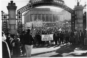 Mario Savio and other student protestors march through Sather Gate on the UC Berkeley campus, heading for a meeting of the UC Regents.  PHOTO BY DON KECHELY  Ran on: 10-10-2004 J. Edgar Hoover keeps an eye on the Free Speech Movement activities of Mario Savio and UC Berkeley students.