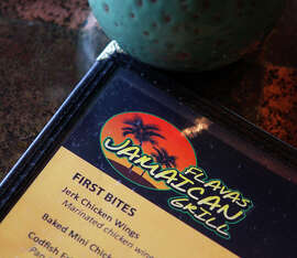 A view of the menu at Flavas Jamaican Grill in South San Francisco.