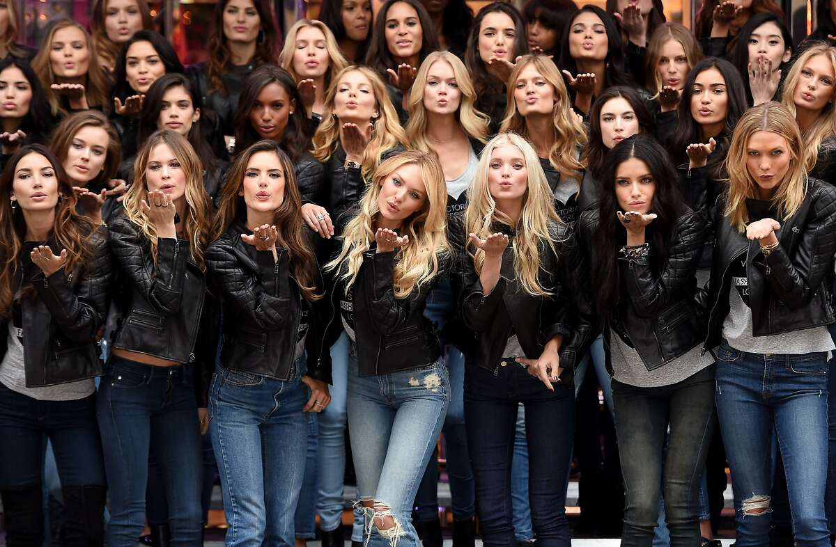 WHERE ARE YOUR WINGS?! Victoria's Secret supermodels - including (front row, from left) Lily Aldridge, Behati Prinsloo, Alessandra Ambrosio, Candice Swanepoel, Elsa Hosk, Adriana Lima and Karlie Kloss - blow kisses during a media event for this year's Victoria's Secret Fashion Show in London.