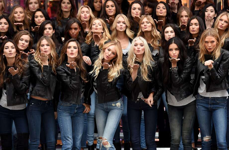 WHERE ARE YOUR WINGS?! Victoria's Secret supermodels — including (front row, from left) Lily Aldridge, Behati Prinsloo, Alessandra Ambrosio, Candice Swanepoel, Elsa Hosk, Adriana Lima and Karlie Kloss — blow kisses during a media event for this year's Victoria's Secret Fashion Show in London. Photo: Dimitrios Kambouris, (Credit Too Long, See Caption)