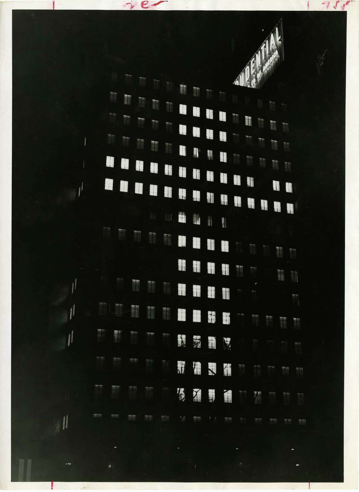 Dec. 24, 1953: The Prudential Building, located at 1100 Holcombe, is lit up for Christmas.