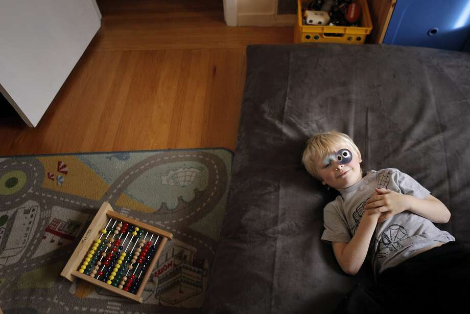 "Bowie, 6, plays with a rubber ball in his family's home in San Francisco, Calif., on Sunday, November 30, 2014. Bowie Wankel, 6, has been diagnosed with Sensory Processing Disorder, and has been receiving treatment and therapy for it. SPD is a condition that makes it hard for people to process sensory input, and like most sufferers, it can affect or disrupt everyday life because of the ""traffic jam"" of signals sent to the brain by the senses. Photo: Carlos Avila Gonzalez, The Chronicle"