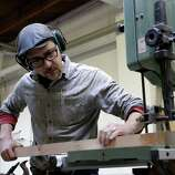 Matt Reynoso, one of the Compound's founders, works in the wood shop in the new addition.