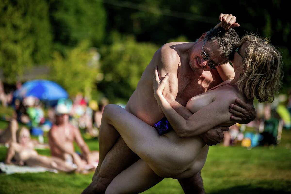 Background checks are a must before any individual is allowed to step foot on the park's grounds. Registered sex offenders of any sort are barred from entry. Cameras of all kinds are strictly prohibited. Here, as hundreds watch, one of several couples dance to the sounds of Fraternity Snoqualmie's annual optional nude concert and celebration, Nudestock, on Saturday, Aug. 23, 2014, in Issaquah. Nudestock, one of the park's largest crowd-drawing events, boasts free reign to swimming pools, campgrounds and live music - with many of the musicians playing in their birthday suits.