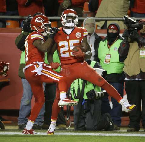 Kansas City Chiefs running back Jamaal Charles (25) celebrates his touchdown with wide receiver Donnie Avery (17) in the second half of an NFL football game against the Denver Broncos in Kansas City, Mo., Sunday, Nov. 30, 2014. (AP Photo/Charlie Riedel)