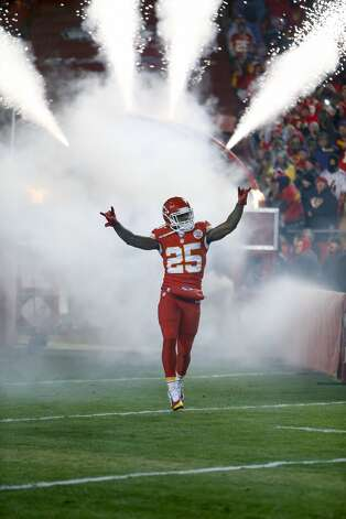 Kansas City Chiefs running back Jamaal Charles (25) is introduced before an NFL football game against the Denver Broncos in Kansas City, Mo., Sunday, Nov. 30, 2014. (AP Photo/Ed Zurga)