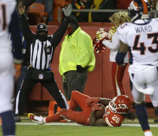Kansas City Chiefs running back Jamaal Charles (25) scores a touchdown in the second half of an NFL football game against the Denver Broncos in Kansas City, Mo., Sunday, Nov. 30, 2014. (AP Photo/Charlie Riedel)