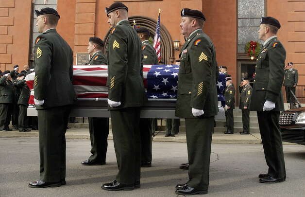 Members of the 42nd Infantry Rainbow Division of the New York National Guard in Troy carry the casket of Sgt. David Fisher, 21, on Dec. 9, 2004, during funeral services at St. Brigid's Church in Watervliet, N.Y. Fisher died while serving in Iraq. (Will Waldron/Times Union archive) Photo: WILL WALDRON / ALBANY TIMES UNION