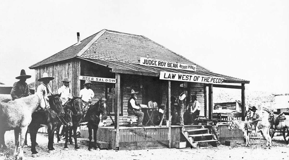 Judge Roy Bean, the 'Law West of the Pecos', holding court at the town of Langtry, Texas, trying a horse thief. This building was the courthouse and the saloon. There were no other peace officers in the locality at that time. 1900. (AP Photo)