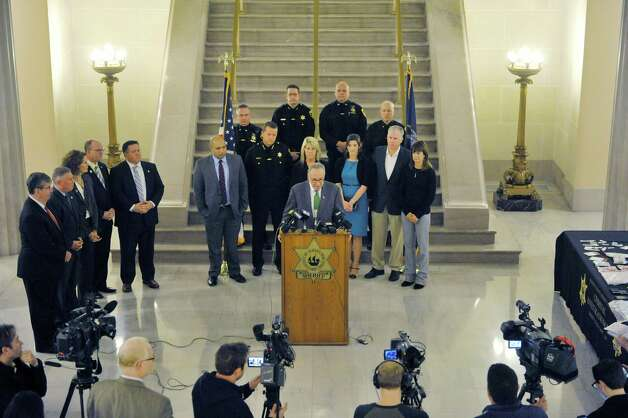 "Senator Chuck Schumer, at podium, along with area elected officials, members of law enforcement and family members who have dealt with heroin addiction, take part in a press conference at the Albany County Courthouse on Monday, Dec. 1, 2014, in Albany, N.Y.  The press event was held for Senator Chuck Schumer to talk about his proposal for $100 million in federal funding to create a law enforcement ""heroin surge"" to combat the drug.  (Paul Buckowski / Times Union) Photo: Paul Buckowski / 00029667A"