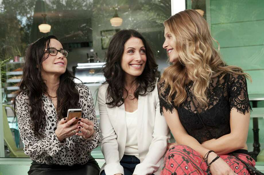 """Janeane Garofalo as lawyer Lyla (left) and Beau Garrett as ex-model Phoebe flank Lisa Edelstein as the cheated-on wife and author Abby in """"Girlfriends' Guide to Divorce."""" Photo: Bravo / Carole Segal / Bravo / 2014 Bravo Media, LLC"""