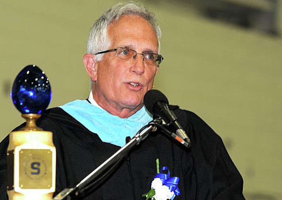 John Dodig, the principal of Staples High School for the last 11 years  -- shown here at the schools 2013 commencement -- announced Monday that he plans to retire at the end of the current academic year. Photo: File Photo / Westport News