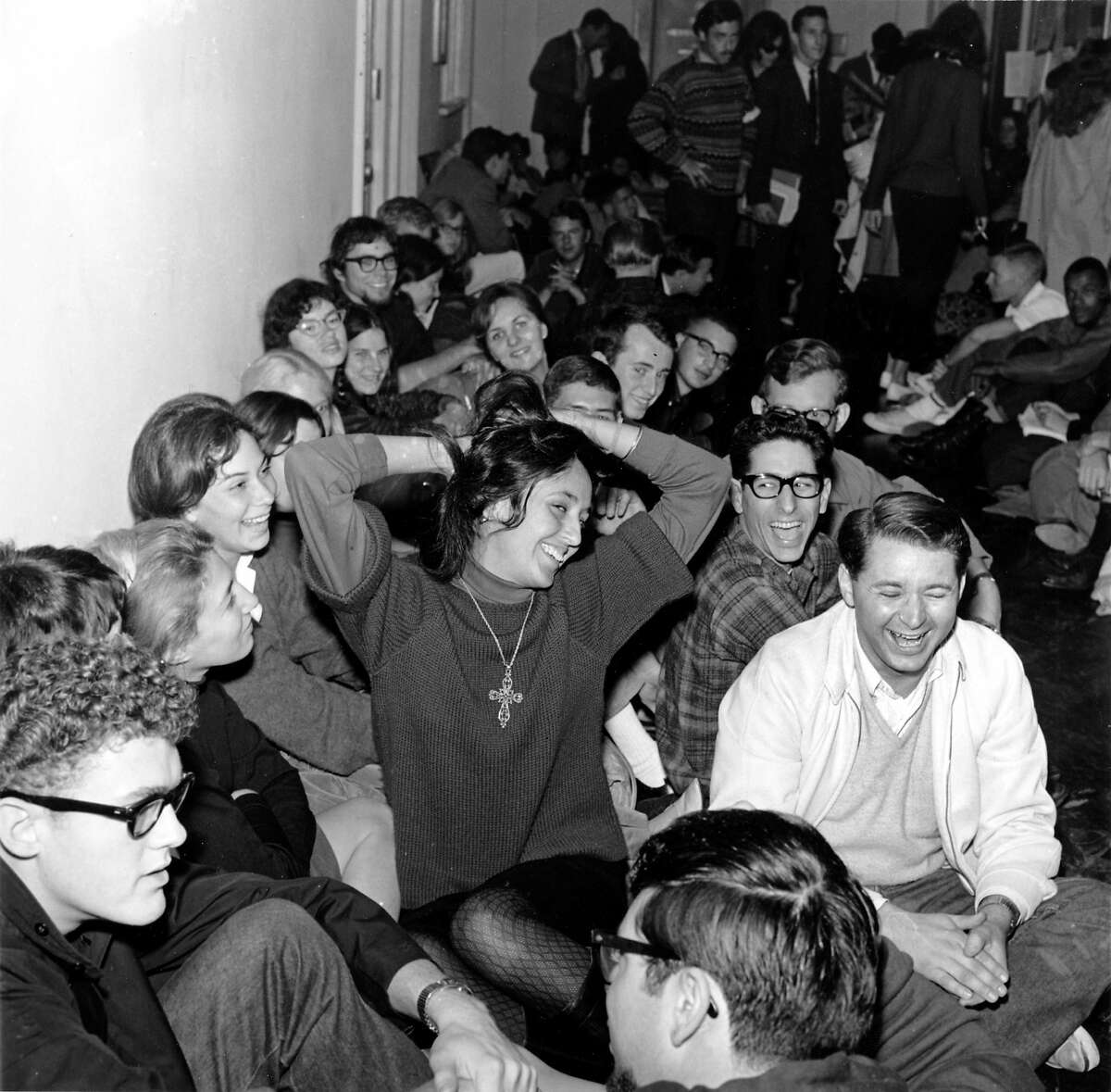 In this Dec. 2, 1964 file photo, folk singer Joan Baez clowns as she sits with student demonstrators in Sproul Hall on the University of California campus in Berkeley, Calif.