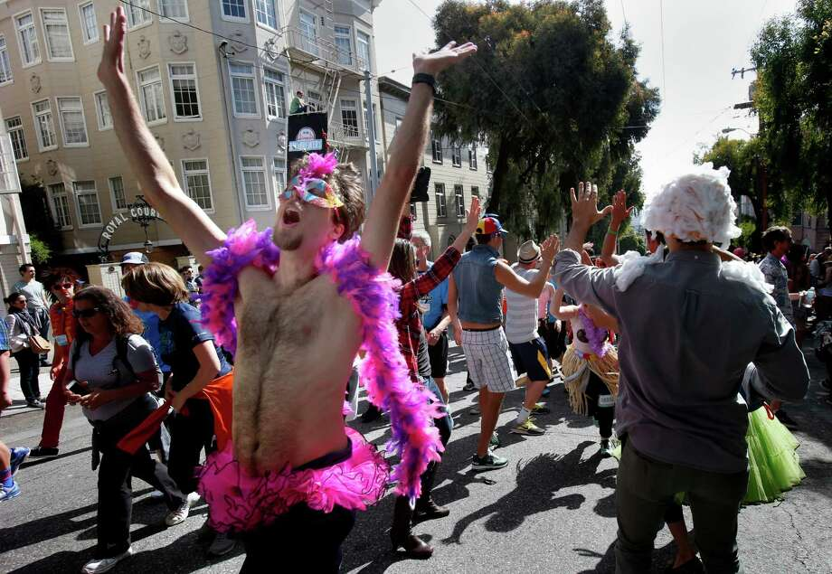 People in costume rejoiced in their making it to the top of the hill. The annual Bay to Breakers event in San Francisco, Calif. attracted thousands of runners and revelers as they made their way up the Hayes Street Hill Sunday May 18, 2014. Photo: Brant Ward, File Photo / ONLINE_YES
