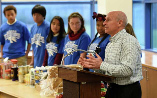Mark Quandt, executive director of the Regional Food Bank, joins students from the Myers Middle School as they announce the 2014 CDPHP Holiday Appeal to feed less fortunate children Monday morning, Dec. 1, 2014, in Albany, N.Y. (Skip Dickstein/Times Union) Photo: SKIP DICKSTEIN / 00029657A