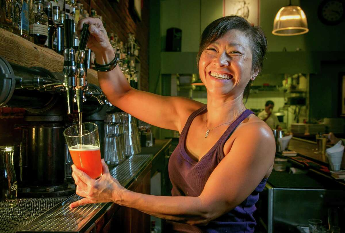 """Bartender Cindy Young pours a """"Red Chair"""" IPA nitro beer from Deschutes Brewery at Louie's Bar in San Francisco, Calif., on Thursday, April 10th, 2014."""