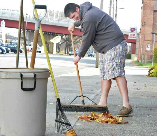 Still wearing shorts, today's low temperatures don't bother Michael Hayner of Watervliet as he picks up leaves at the Parker Bros. Funeral Home on Broadway Tuesday Nov. 18, 2014, in Watervliet, NY.  (John Carl D'Annibale / Times Union) Photo: John Carl D'Annibale, Albany Times Union