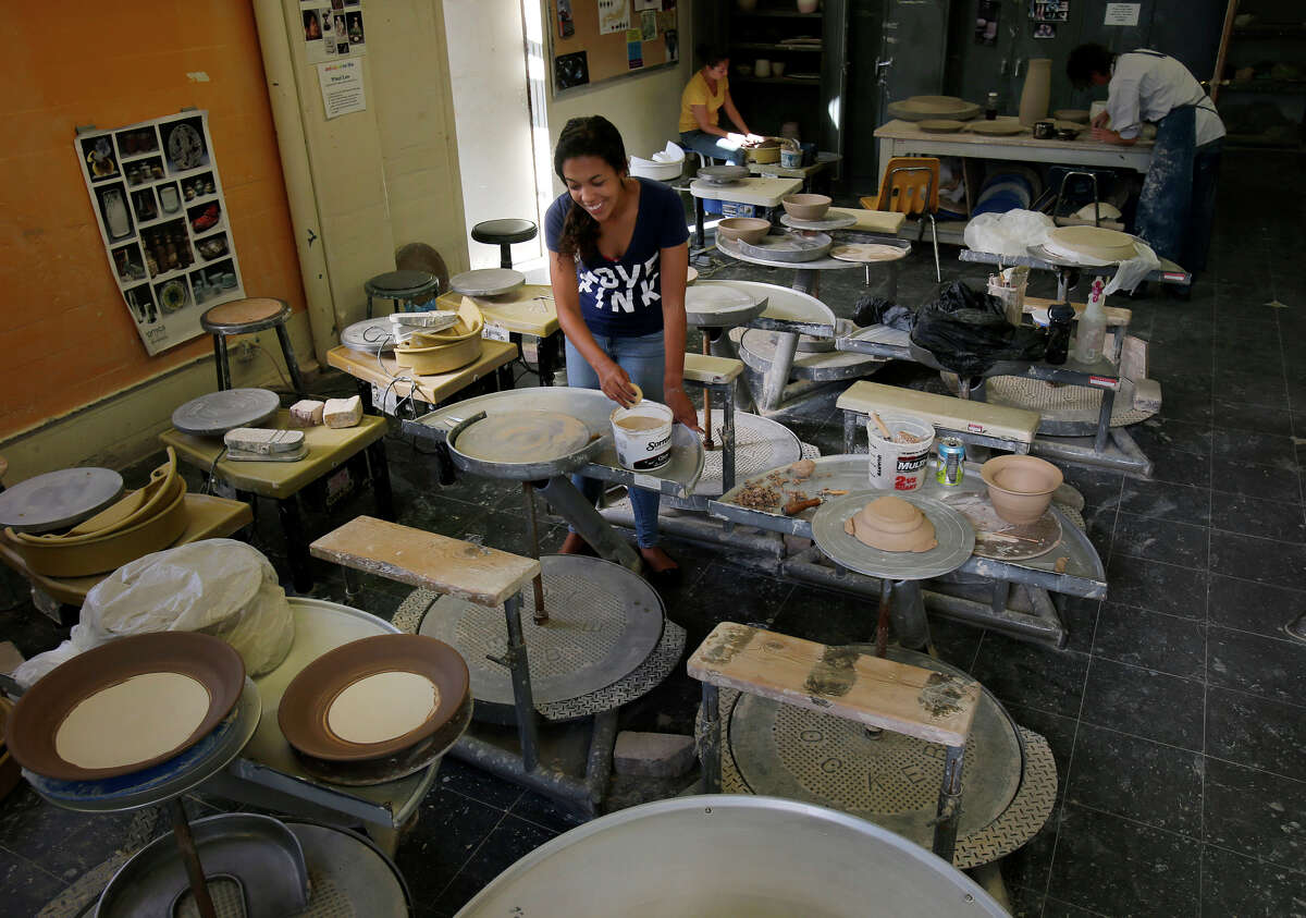 Students at City College of San Francisco's arts campus work in the ceramics studio at Fort Mason Center, which is in talks with the 143-year-old S.F. Art Institute as the anchor tenant. The school's president expects to announce a plan in May.