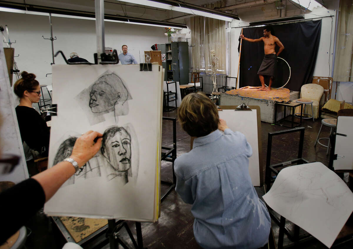 Students illustrate a model during a drawing class at City College of San Francisco's arts campus at Fort Mason Center.
