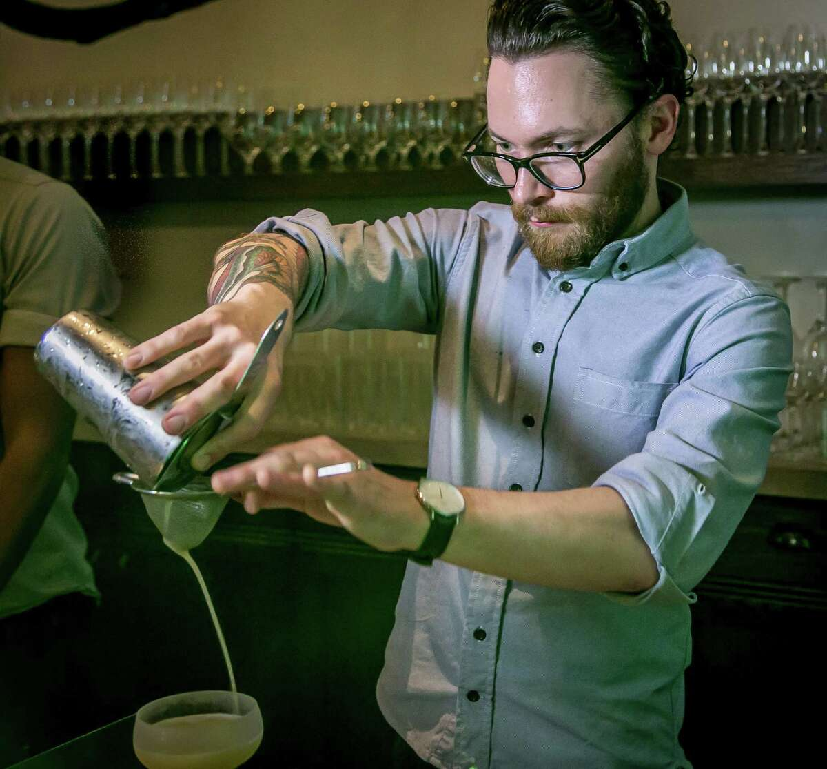 Bartender Colin Gallagher makes the Sleepyhead cocktail at Trou Normand.