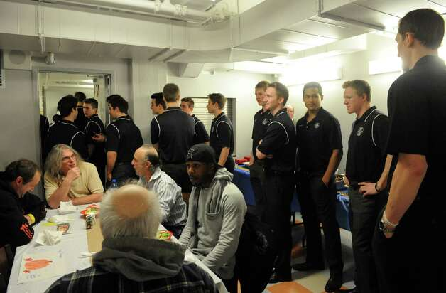 Union College hockey players were on hand to volunteer serving meals during the YMCA men's residence Thanksgiving dinner on Tuesday Nov. 25, 2014 in Schenectady, N.Y. (Michael P. Farrell/Times Union) Photo: Michael P. Farrell, Albany Times Union / 00029632A