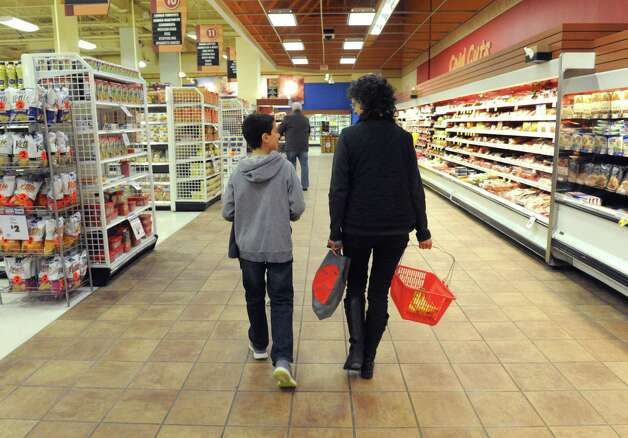 Liam Epstein and his mother Sue Epstein shop at the Ballston Avenue Price Chopper on Saturday Nov. 29, 2014 in Saratoga Springs, N.Y. (Michael P. Farrell/Times Union) Photo: Michael P. Farrell / 00029672A