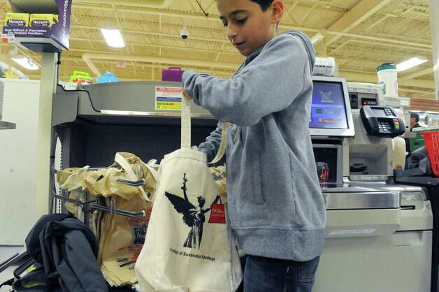 Twelve-year-old Liam Epstein and his mother Sue Epstein shop at the Ballston Avenue Price Chopper on Saturday Nov. 29, 2014 in Saratoga Springs, N.Y. (Michael P. Farrell/Times Union) Photo: Michael P. Farrell / 00029672A