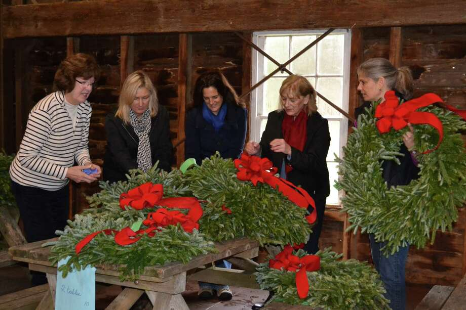 Fort Orange Garden Club members prepare wreaths for a Holiday Greens Boutique to be held from 10 a.m. to 5 p.m. Friday, Dec. 5, and Saturday, Dec. 6, at the Verdoy Schoolhouse, on the Pruyn House property, 207 Old Niskayuna Road. It features fresh centerpieces, potted bulbs, swags, hostess gifts and wreaths. From left are Maggie Vinciguerra, co-chair Ways and Means; Susan Brown; Laura Britton; Jan Despart, co-chair Ways and Means and Christine Standish. (Carolyn Martel)