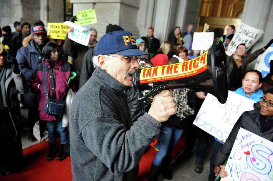Albany County Legislator Doug Bullock, primary sponsor of the county's ban on polystyrene foam containers, leads activists in a chant as they demand legislative reform, including raising the minimum wage, at a 2013 protest. (Cindy Schultz / Times Union) Photo: Cindy Schultz / 00021331A