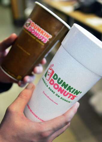 A paper cup, left, and a polystyrene foam coffee cup last year at the Dunkin' Donuts Western Avenue in Albany.  (John Carl D'Annibale / Times Union) Photo: John Carl D'Annibale / 00025028A