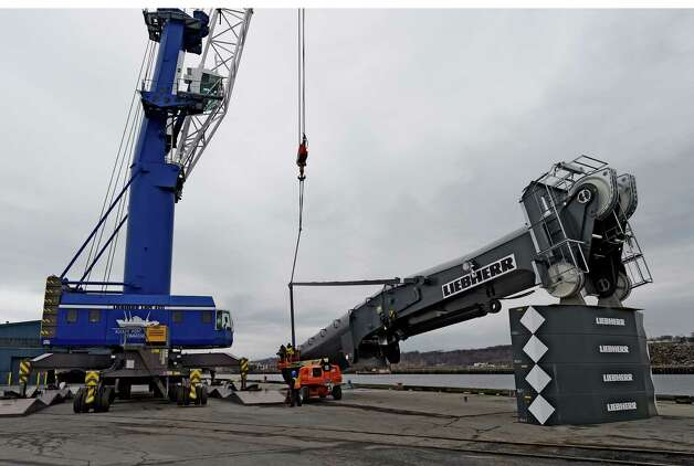 Workers from Germany assemble a new crane at the Port of Albany Monday Dec. 1, 2014 in Albany, N.Y. The new crane will have greater lifting ability than the present cranes on site at the Port. (Skip Dickstein/Times Union) Photo: SKIP DICKSTEIN / 00029681A