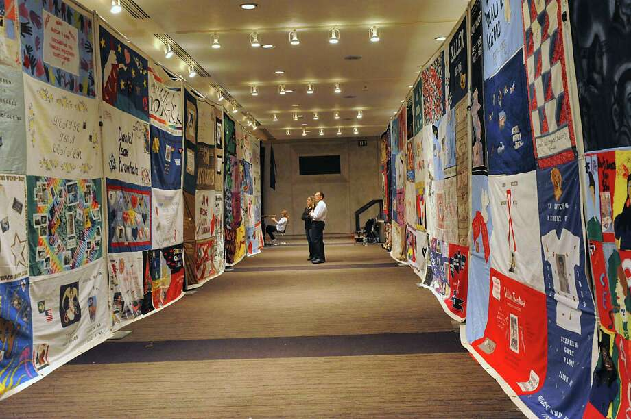 People look at the AIDS Memorial Quilt displayed by The NAMES Project Foundation in the Convention Center on World AIDS Day at the Empire State Plaza on Monday, Nov. 1, 2014 in Albany, N.Y. (Lori Van Buren / Times Union) Photo: Lori Van Buren / 00029677A