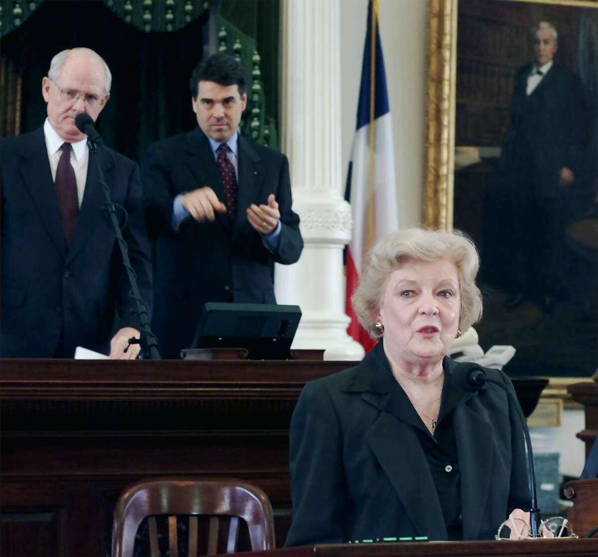 Betty King, foreground, Secretary of the Texas Senate, prepares to speak to members of the Senate during ceremonies honoring her Thursday, April 26, 2001, in Austin, Texas. Applauding in the background are acting Lt. Gov. Bill Ratliff, left, and Gov. Rick Perry.