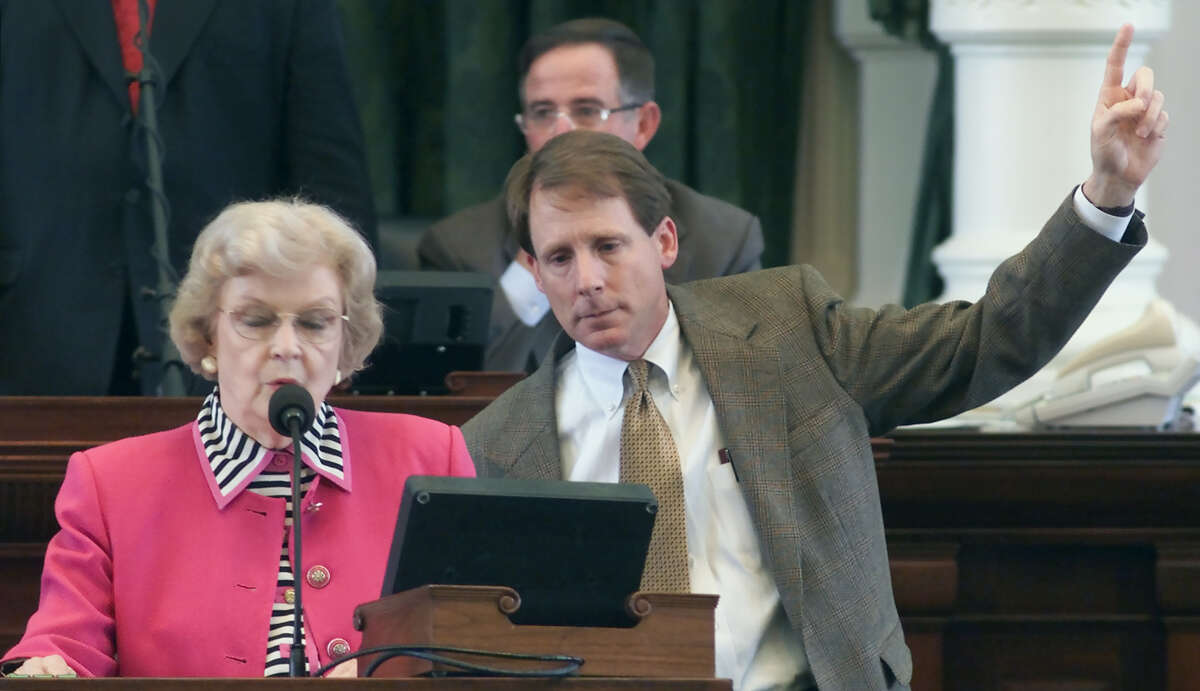 State Sen. Robert Duncan, R-Lubbock, right, signals his 'aye' vote as he watches the roll call on his measure that could end Texas' long tradition of electing appeals court judges, Wednesday, April 25, 2001, in Austin, Texas. On left is Secretary of the Senate Betty King.