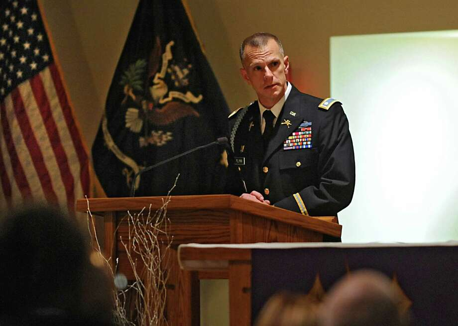 Lieutenant Colonel Sean Flynn speaks during a Catholic Mass and tribute ceremony held to remember Army Sgt. David Fisher on the 10th anniversary of his death at the Immaculate Heart of Mary Parish on Monday, Nov. 1, 2014 in Watervliet, N.Y. (Lori Van Buren / Times Union) Photo: Lori Van Buren / 00029693A