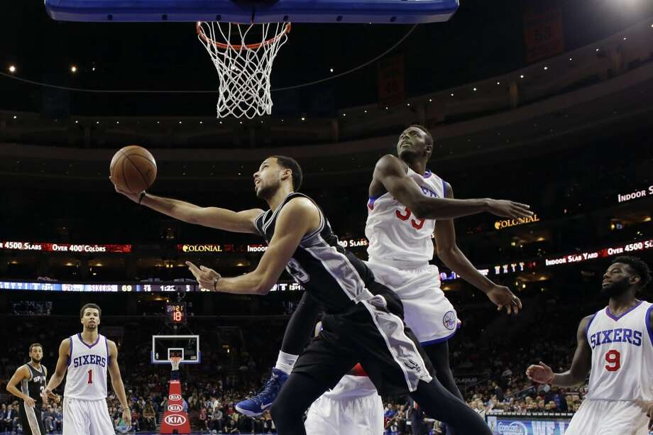 San Antonio Spurs' Austin Daye (23) goes up for a shot against Philadelphia 76ers' Jerami Grant (39) during the second half of an NBA basketball game, Monday, Dec. 1, 2014, in Philadelphia. San Antonio won 109-103. (AP Photo/Matt Slocum) Photo: AP