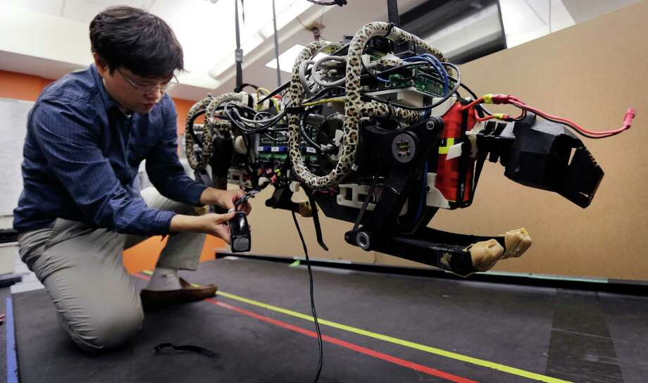 "Research and experimentation (Development) creditAccording to the Bipartisan Policy Center, the R&E tax credit ""is a tax provision designed to incentivize innovation by making research activities cheaper for businesses.""In this Sept. 30, 2014 photo, researcher Hae Won Park plugs the batteries into a robotic cheetah at the Massachusetts Institute of Technology in Cambridge, Mass. Photo: Charles Krupa, STF / AP"