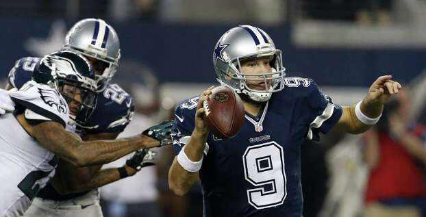 Philadelphia Eagles cornerback Nolan Carroll pressures as Dallas Cowboys' Tony Romo (9) scrambles out of the pocket trying to pass during the second half of an NFL football game, Thursday, Nov. 27, 2014, in Arlington, Texas. (AP Photo/John F. Rhodes) Photo: John F. Rhodes, Associated Press / FR170608 AP