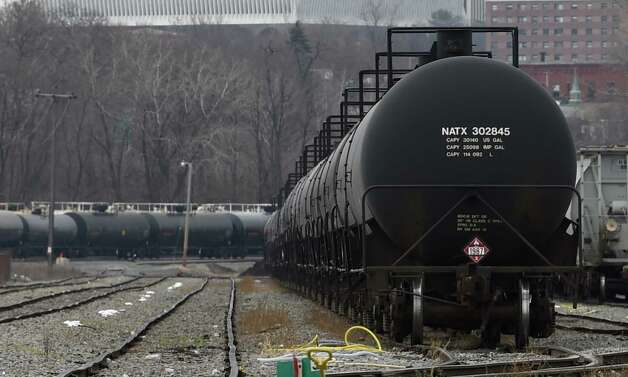 Oil tank cars sit idle at the Port of Albany Monday afternoon, Dec. 1, 2014, in Albany, N.Y.  (Skip Dickstein/Times Union) Photo: SKIP DICKSTEIN / 00029678A