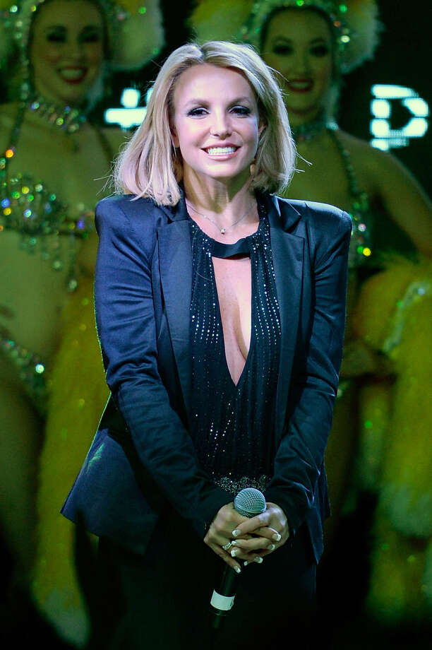 """Singer Britney Spears appears on stage at The LINQ Promenade on Wednesday, Nov. 5, 2014, in Las Vegas. Caesars Entertainment proclaimed Wednesday as """"Britney Day,"""" and the entertainer was presented with a key to the city and an official Clark County proclamation. (Photo by Jeff Bottari/Invision/AP) ORG XMIT: NVJB002 Photo: Jeff Bottari / Invision"""